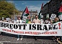 Demonstrating against Israeli crimes; pushing the boycott campaign