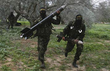 Islamic Jihad fighters run carrying rockets about to be fired into Israel