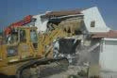 Bulldozers at work, demolishing Palestinian homes...