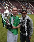 Palestinian footballer Mahmoud Sarsak presenting the Rivals4Charity trophy to  Hibs Skipper Frankie Arthur