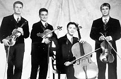 Three Russian immigrants and one native-born Israeli make up the Jerusalem Quartet, ISrael's only professional string quartet. All were inducted into the Israeli Defence Forces last year.  The Quartet is composed of (left to right) Alexander Pavlovsky, Sergei Bressler, Kyril Zlotnikov and Amichai Gross