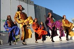 Dancing in Aida Camp under the illegal apartheid Wall