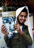 The killer, Eden Natan-Zada, poses with a book by late Rabbi Meir Kahane