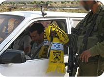 Soldier at checkpoint demands a Palestinian kiss the Beitar scarf to be allowed to pass