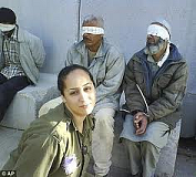The ugly faces of Israel - soldier posing in front of blindfolded Palestinian prisoners